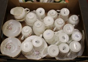 A collection of pink floral tea and coffee ware items: mugs, saucers, cups, milk and sugar etc (1
