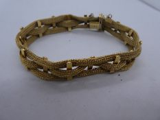 18ct yellow gold bracelet marked 750 with safety chain, weight 27.7g