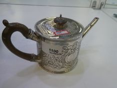 A very decorative George III teapot with foliate embossed design, a carved wooden handle and knob. A