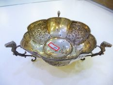 A Victorian silver trinket bowl with scalloped on three feet with animal heads and foliate decorati