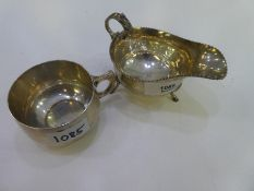 A silver lot comprising of a gray boat with a decorative rim, hallmarked Birmingham 1941 JB Chatterl