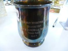 A silver tankard with foliate handle on a raised base, engraved to the front, Hallmarked Sheffield 1