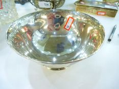A Victorian silver bowl with engraved foliate decoration and central cartouche, with a raised engrav