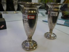 A pair of silver vases with engraved wording hallmarked Birmingham 1926, 1927 possibly Sandes and Ma