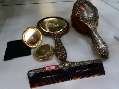 Silver dressing table set consisting of two brushes, hand mirror, comb and compact, mirror and brush