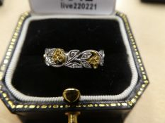 18ct white gold floral design ring inset with yellow sapphires and diamonds, marked 750, gross weigh