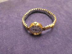 Vintage 9ct yellow gold ladies 'Excalibur' 21 Jewel ladies wristwatch on rolled gold adjustable str