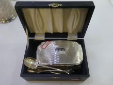 A silver lot comprising of a cased sterling silver topped dressing table brush and comb hallmarked B