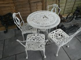 White painted cast iron garden set of 4 chairs and a table
