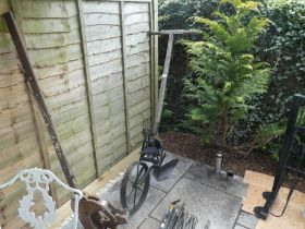 Vintage garden plough and chimney sweeping rods.