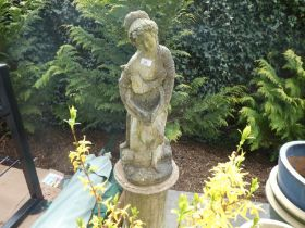 Stone effect garden statue of a lady on a plinth