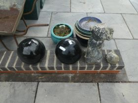 Two painted terracotta black balls and a stone effect statue A/F