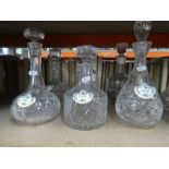 A selection of glass decanters, some with labels and vintage soda syphons