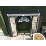 A reproduction metal and tile fireplace