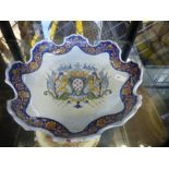 A French Faience Armorial plate having shaped rim, possibly 18th Century 27.5cm and a Chinese export
