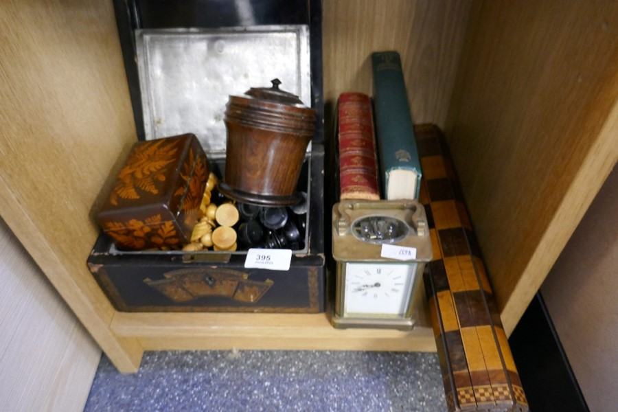 A boxwood chess set, a brass carriage clock, a rolling chessboard, an oriental tea caddy and sundry