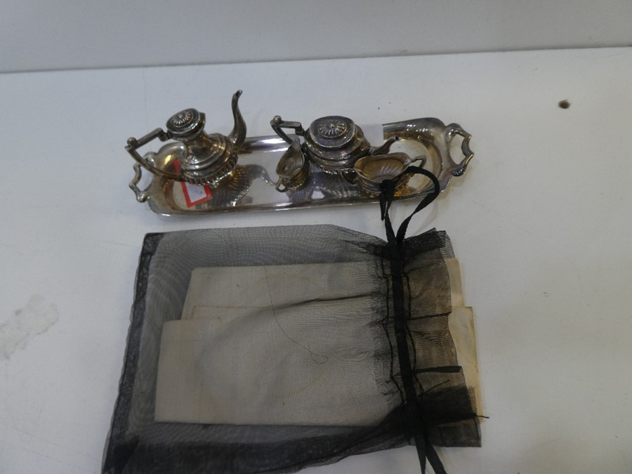 A very pretty, decorative miniature silver tea set comprising of a tray, tea and coffee pot and two - Image 2 of 2