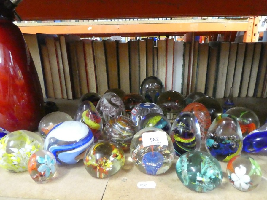 A selection of glass paperweights, including one by Wedgwood