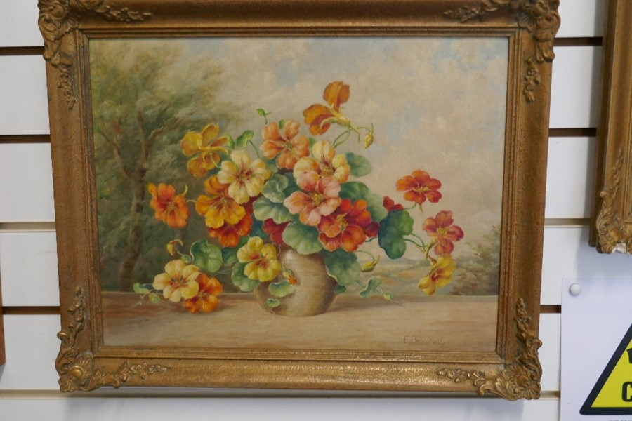 E Bromhall: an oil of a vase of flowers and an oil of a woodland path. The largest 59.5 x 49.5cms - Image 6 of 7