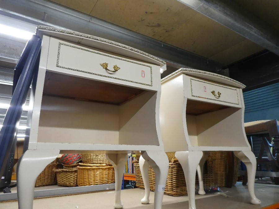 Two painted cream and gold gilded bedside tables