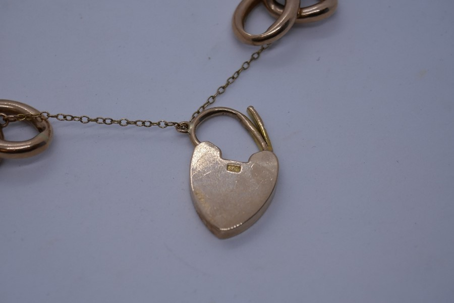 9ct rose gold bracelet with heart shaped clasp and safety chain, marked 375, 24.9g in a blue leather - Image 2 of 5