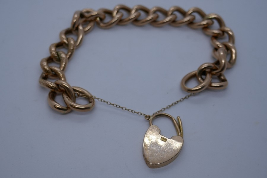 9ct rose gold bracelet with heart shaped clasp and safety chain, marked 375, 24.9g in a blue leather