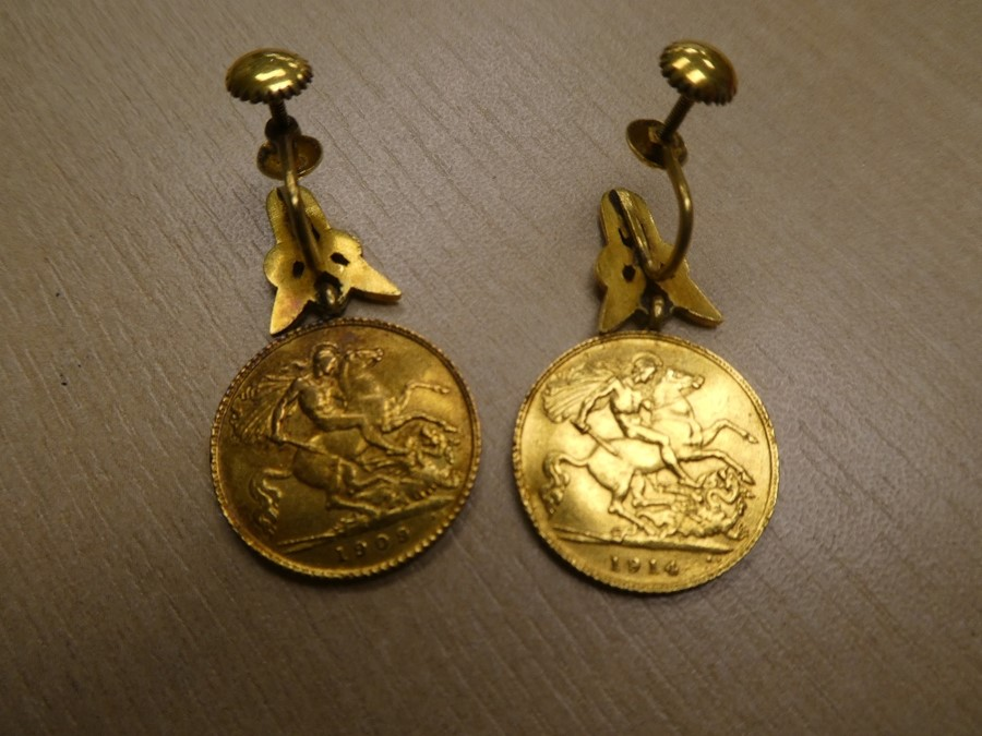 Pair of yellow metal earrings each hung with a half Sovereign, 1909 and 1914, gross weight 11.6g