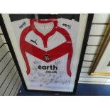 A St Helens rugby shirt bearing signatures, presumably of the team, framed and glazed