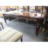 A mahogany Victorian style oblong dining table, 226 cms