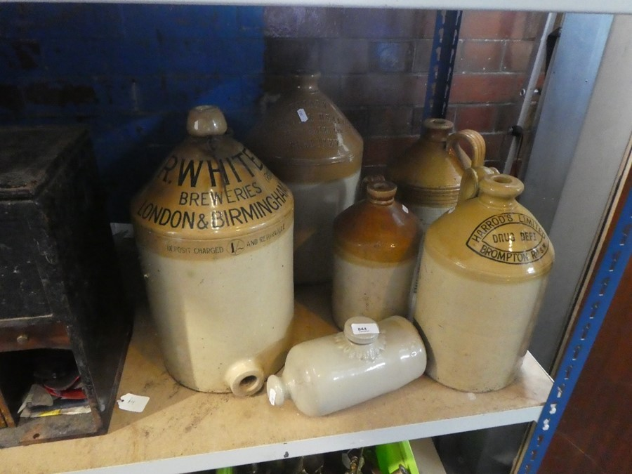 A selection of stoneware jugs, one inscribed R-White Brewery, London & Birmingham
