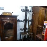 Antique carved oak hall stand having 11 pegs, 98cm wide