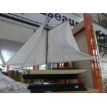 Wooden model of a sailing ship on plinth named ;The Lady Linda'