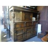 A Reproduction oak court cupboard having carved decoration and a similar cocktail cabinet