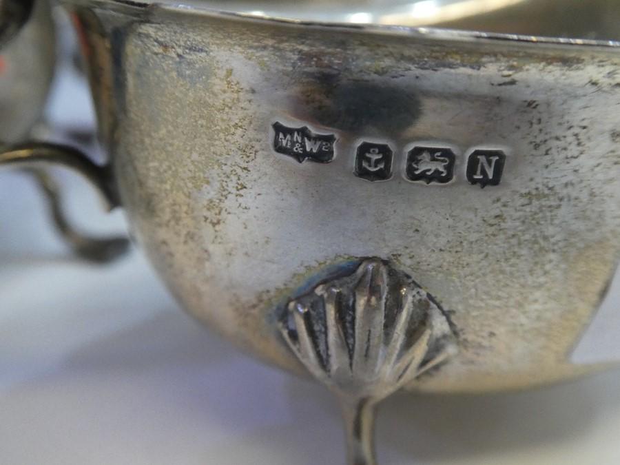 A silver sauceboat hallmarked, Birmingham 1927 Adie Brothers Ltd, also a silver hallmarked sugar bow - Image 4 of 5