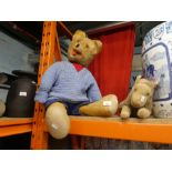 A vintage bear and much loved vintage Lion with zip for night clothes and a shelf of teddy bears