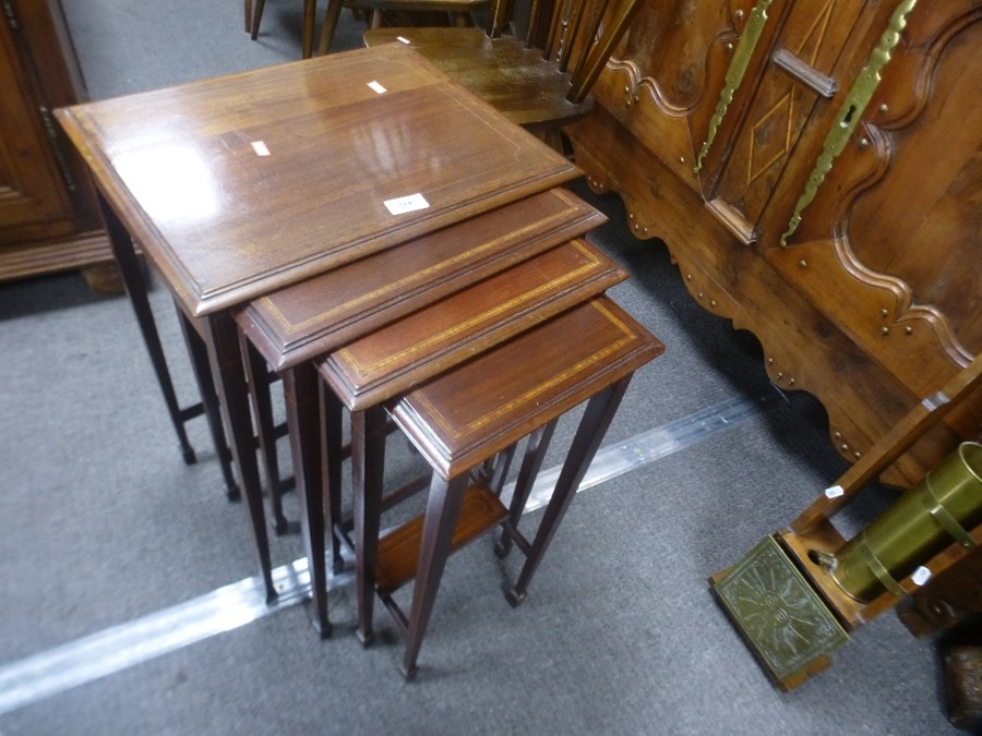 Inlaid mahogany nest of 4 tables, probably Edwardian