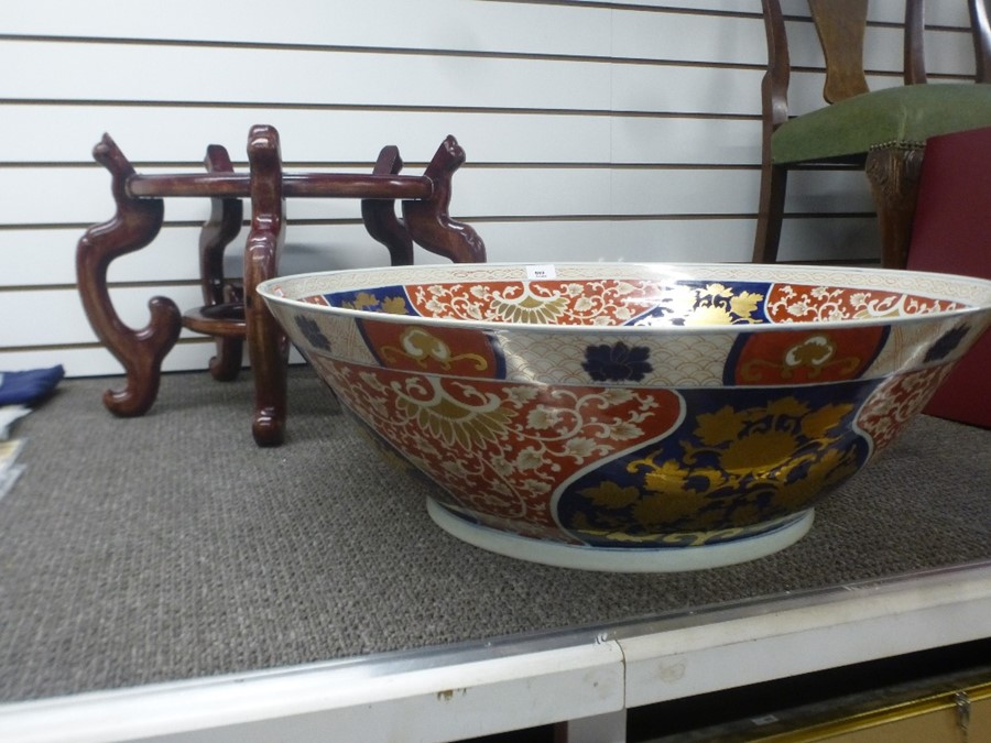 A 20th Century Chinese bowl, interior decorated with fish 68cm on wooden stand