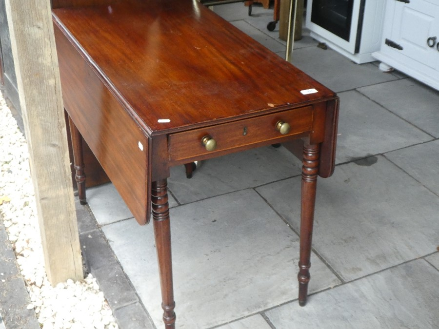 A brass and glass tea trolley and a drop leaf table on barley twist supports