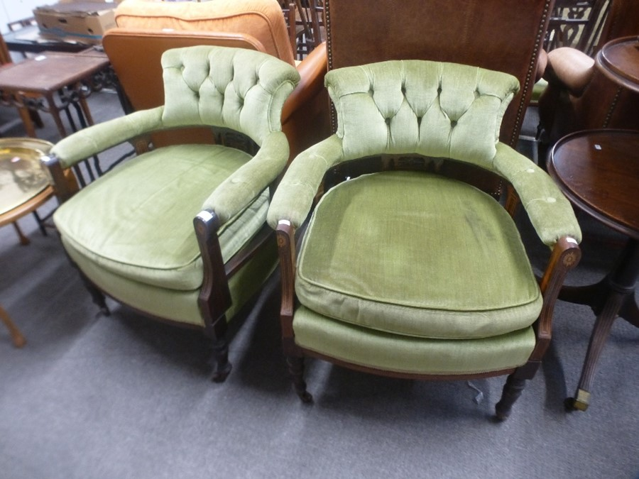 A pair of late Victorian tub armchairs having inlaid decoration with button back.