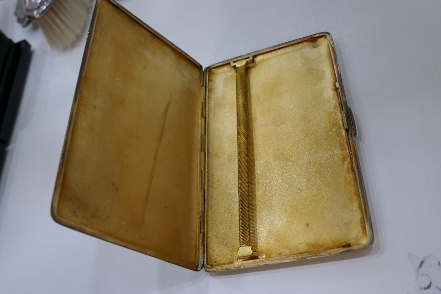 A large heavy silver cigarette case with gilt interior and engine turned exterior, Chester 1946, Don - Image 2 of 6