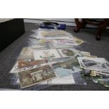 A quantity of old post cards, a flag and sundry items