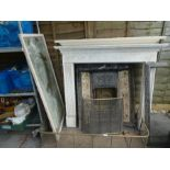 Cast iron tiled fireplace, with two wooden surround, brass fender, mirror, etc