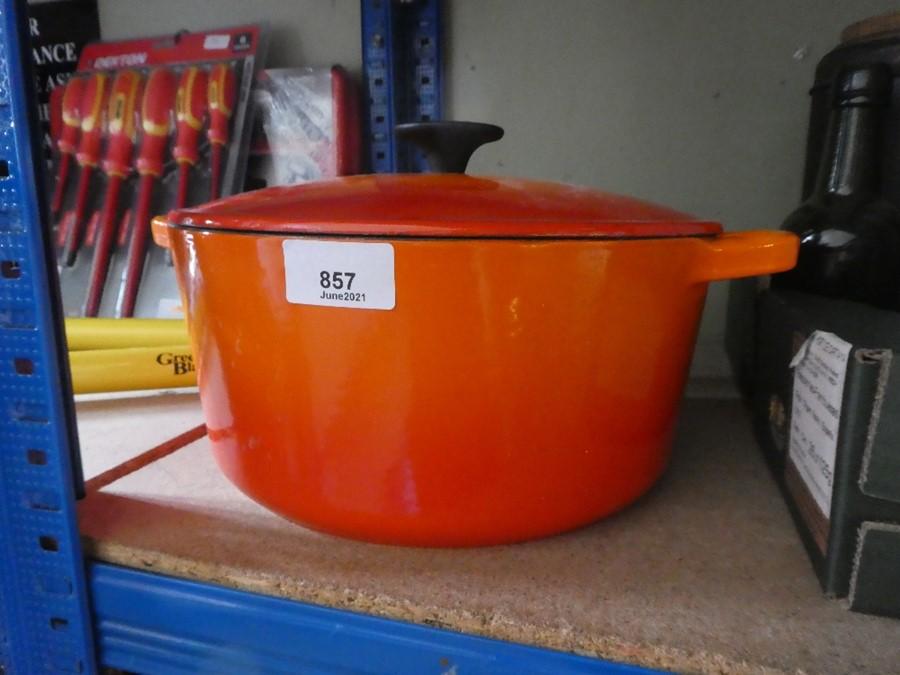 A large Le Creuset orange cooking pot