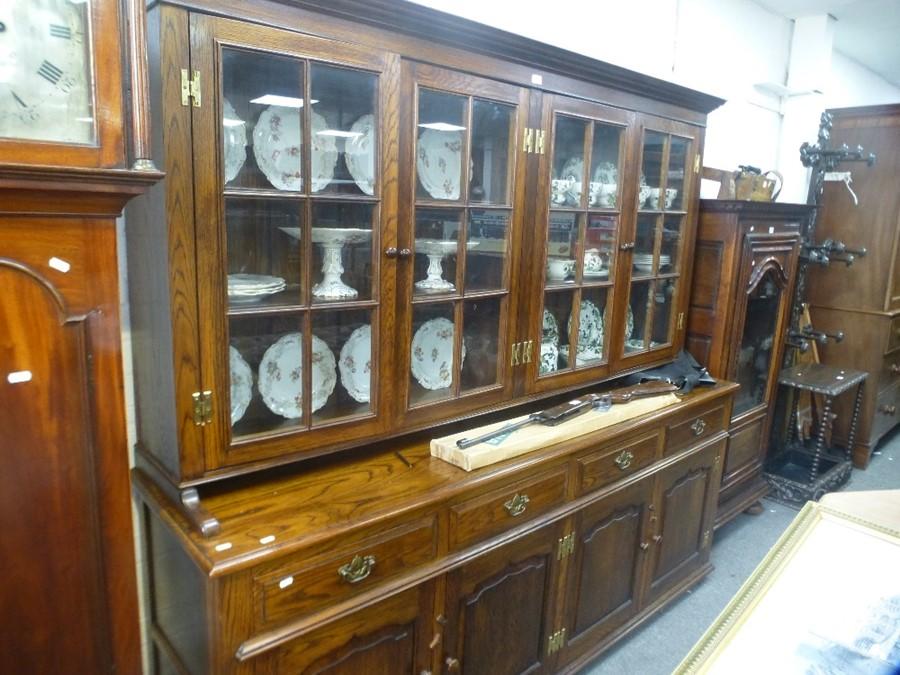 A Reproduction bespoke oak dresser with glazed top, 203 cms