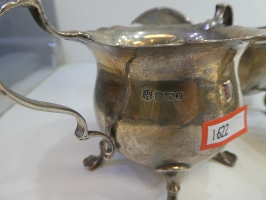A silver sauceboat hallmarked, Birmingham 1927 Adie Brothers Ltd, also a silver hallmarked sugar bow - Image 2 of 5