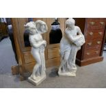Two marble style statues of semi nude ladies