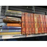 A shelf of hard back books, History of War, and fishing books