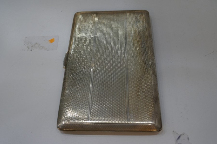 A large heavy silver cigarette case with gilt interior and engine turned exterior, Chester 1946, Don - Image 6 of 6