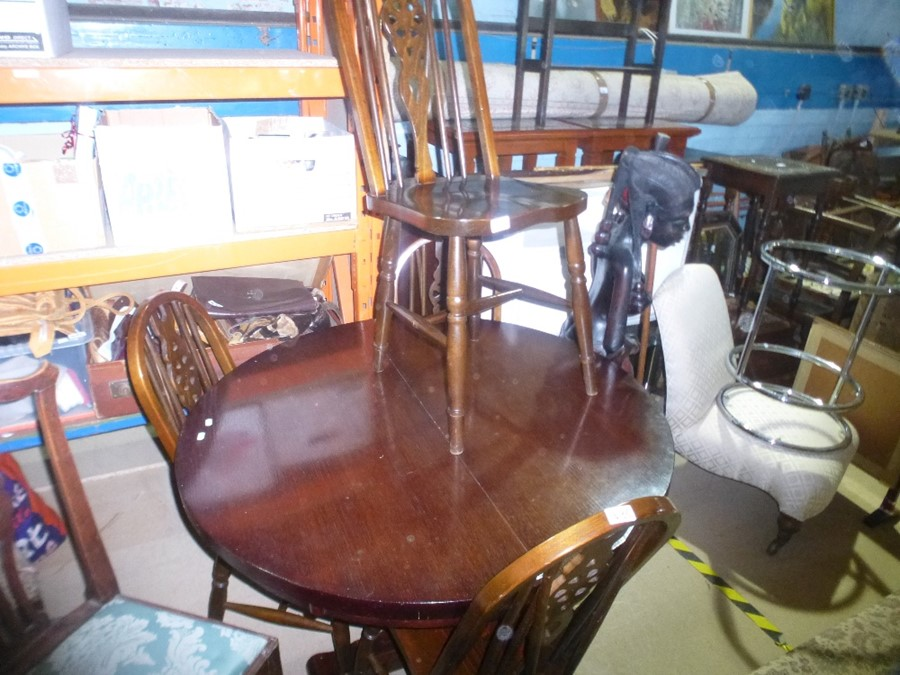 A Round wind out table with 4 matching chairs