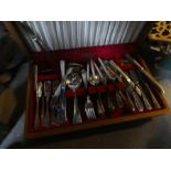 A box of brass items including coffee pots, oil lamps AF and a part cutlery set